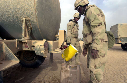 Lt1. Rodney McCutcheon (SC) fills a five gallon jug with potable water from a tank at the Task Force 3-69 assembly area on March 30, 2003, in the South Central Iraqi desert. With supply lines falling behind, troops are rationing water to two 1.5 liter bottles a day per person.  Photo: BAHRAM MARK SOBHANI, SAN ANTONIO EXPRESS NEWS / SAN ANTONIO EXPRESS NEWS