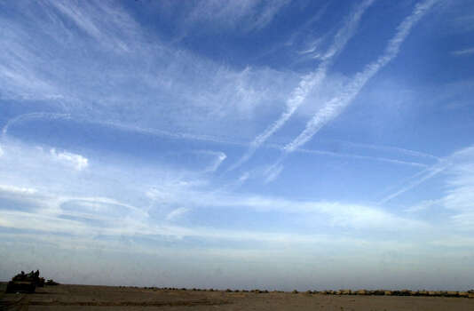Vapor trails from Air Force bombers fill the sky near Karbala on April 1, 2003, in Iraq. U.S. troops pushed north toward the crucial city on their way to Baghdad. Photo: BAHRAM MARK SOBHANI, SAN ANTONIO EXPRESS NEWS / SAN ANTONIO EXPRESS NEWS