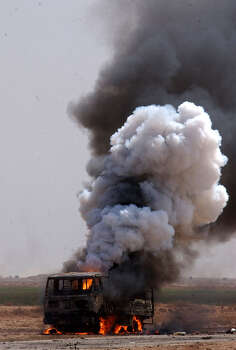 An Iraqi vehicle burns and after being attacked by Apache helicopters north of Karbala on April 2, 2003, in Iraq. Task Force 3-69 pushed north Wednesday, securing a bridge considered essential to U.S. plans. Photo: BAHRAM MARK SOBHANI, SAN ANTONIO EXPRESS NEWS / SAN ANTONIO EXPRESS NEWS