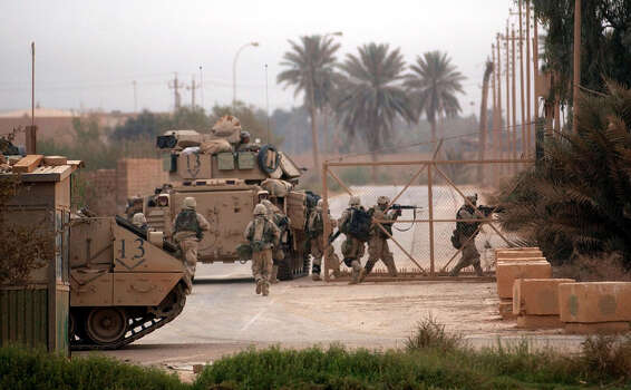 Third Infantry Division ground forces secure a gated area at Saddam International Airport early Friday, April 4, 2003, in Iraq. Photo: BAHRAM MARK SOBHANI, SAN ANTONIO EXPRESS NEWS / SAN ANTONIO EXPRESS NEWS