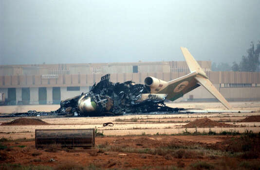 A bombed out plane shows the aftermath of overnight fighting for control of Saddam International Airport early Friday on April 4, 2003, outside of Baghdad Iraq. U.S. and Iraqi troops clashed overnight.  Photo: BAHRAM MARK SOBHANI, SAN ANTONIO EXPRESS NEWS / SAN ANTONIO EXPRESS NEWS