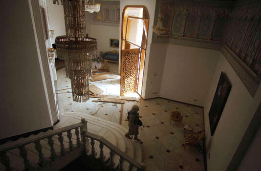 A U.S. soldier walks through a large house Saturday, April 5, 2003. near Saddam International Airport in Iraq. Task Force 3-69 is using furniture from nearby mansions to use in the command center they are setting up at the airport. Photo: BAHRAM MARK SOBHANI, SAN ANTONIO EXPRESS NEWS / SAN ANTONIO EXPRESS NEWS