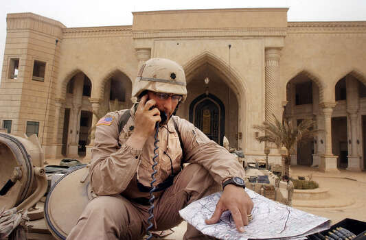 Col. Rock Marcone keeps communications with other 1st Brigade elements after taking over one of Saddam Hussein's palaces on April 7, 2003, in western Baghdad. Troops took the palace with little resistance. Photo: BAHRAM MARK SOBHANI, SAN ANTONIO EXPRESS NEWS / SAN ANTONIO EXPRESS NEWS