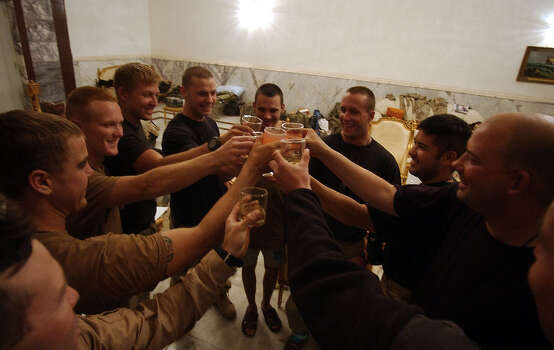 Member of the 15th Air Support Operations Squadron toast each other on their last night together on April 17, 2003, at Presidential Palace North in western Baghdad. Some of the crew will begin the process of deploying home while others will remain to serve at the division level.  Photo: BAHRAM MARK SOBHANI, SAN ANTONIO EXPRESS NEWS / SAN ANTONIO EXPRESS NEWS
