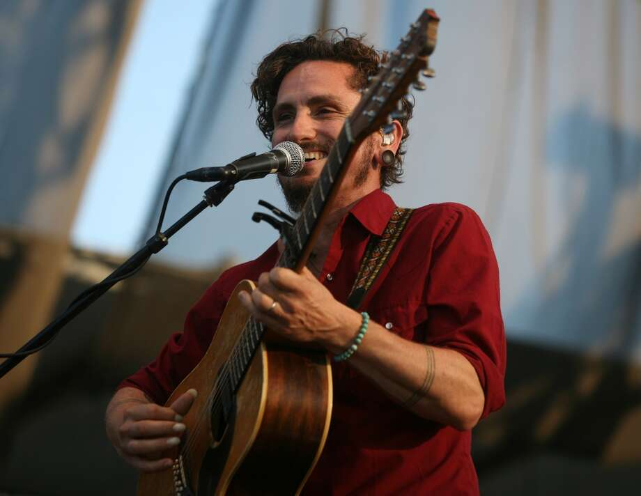 John Butler of the John Butler Trio performs at the Gathering of the Vibes music festival at Seaside Park in Bridgeport on Sunday, July 24, 2011. The band is slated to return to the festival this summer.