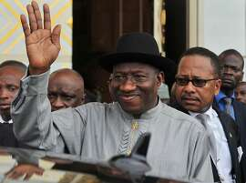 Nigeria's President Goodluck Johnathan waves as he leaves the Felix Houphouet-Boigny fundation in Yamoussoukro on Febuary 27, 2013 after the opening ceremony of the ECOWAS ordinary summit. West African nations will need aid worth $950 million (715 million euros) to sustain and reinforce a military mission to help fight Islamists in Mali, Ivory Coast's Foreign Minister Charles Koffi Diby said today. AFP PHOTO / ISSOUF SANOGOISSOUF SANOGO/AFP/Getty Images