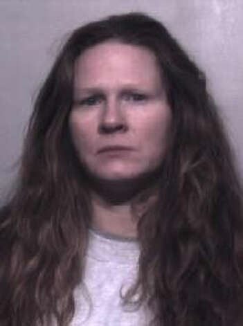 Charlotte Ann Clark, 40, was previously convicted of robbery in Pierce County. She also goes by Charlotte Ann Hatch. A warrant for the Oregon woman's arrest was issued Dec. 26, 2012. Anyone with information can contact the Department of Corrections at 866-359-1939 or by visiting doc.wa.gov. Photo: Department Of Corrections Photo