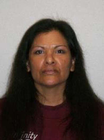 Maria Lena Fuentes, 48, was previously convicted of assault as well as gun and drug crimes in Spokane County. She also goes by Maria Christensen, Maria Lena Feuentes and Maria L. Hudson. A warrant for the Montana woman's arrest was issued Jan. 16, 2013. Anyone with information can contact the Department of Corrections at 866-359-1939 or by visiting doc.wa.gov. Photo: Department Of Corrections Photo