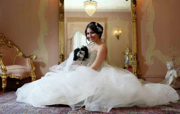 (Vanessa Arauco with Charlie, the rescue shih-tzu )