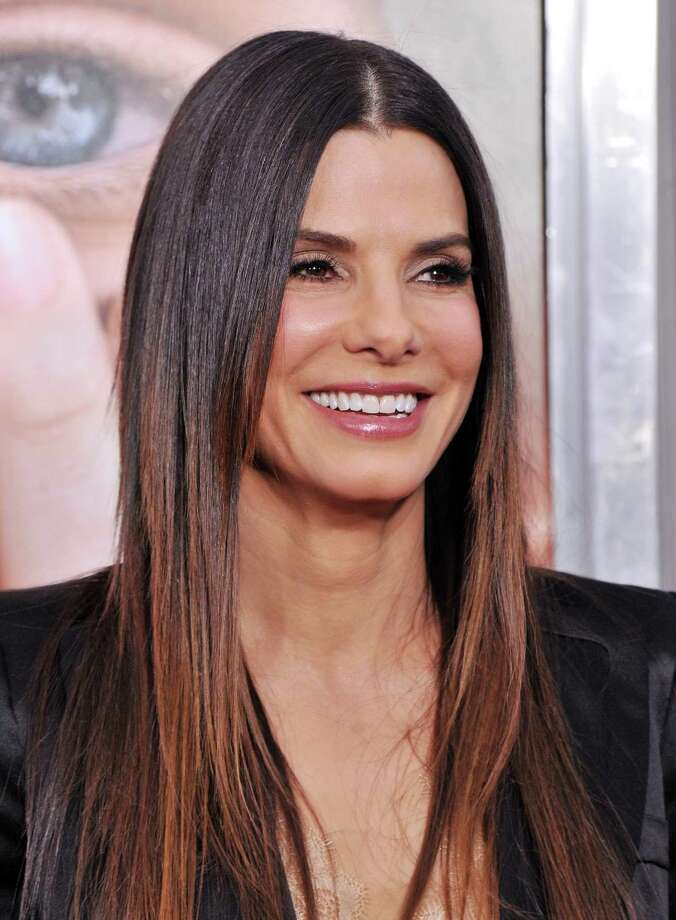 Sandra Bullock was going through a very public divorce when she adopted her son Louis as a single mom. She has since adopted a second child. Photo: Stephen Lovekin, Getty / 2011 Getty Images