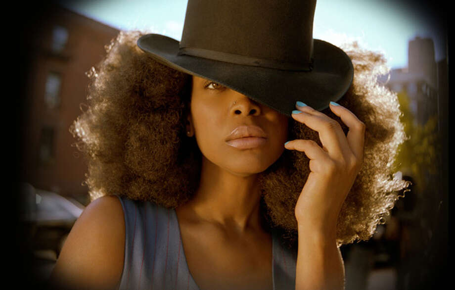 Erykah Badu has three children from three different fathers. She has never been married. / handout