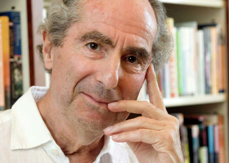 FILE - In this Sept. 8, 2008 file photo, author Philip Roth poses for a photo in the offices of his publisher Houghton Mifflin, in New York.  Roth turned 80 on Tuesday, March 19, 2013 and he's in his hometown Newark, N.J., for the occasion, where several events are planned in his honor.  (AP Photo/Richard Drew, file) Photo: Richard Drew