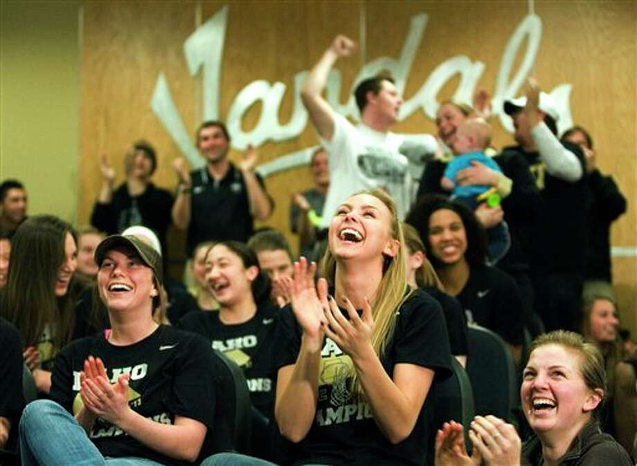 Members of the Idaho womens basketball team react on Monday, March 18, 2003, in Moscow, Idaho, after learning they will play Connecticut in the first round of the NCAA tournament on Saturday, March 23. (AP Photo/Moscow-Pullman Daily News, Geoff Crimmins)