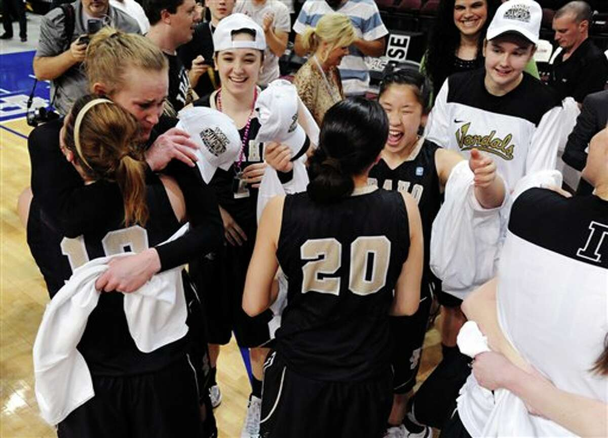 In this photo provided by the Las Vegas News Bureau, Idaho players celebrate their 67-64 win over Seattle in an NCAA college basketball game in the Western Athletic Conference women's tournament championship, Saturday, March 16, 2013, in Las Vegas. (AP Photo/Las Vegas News Bureau, Brian Jones)