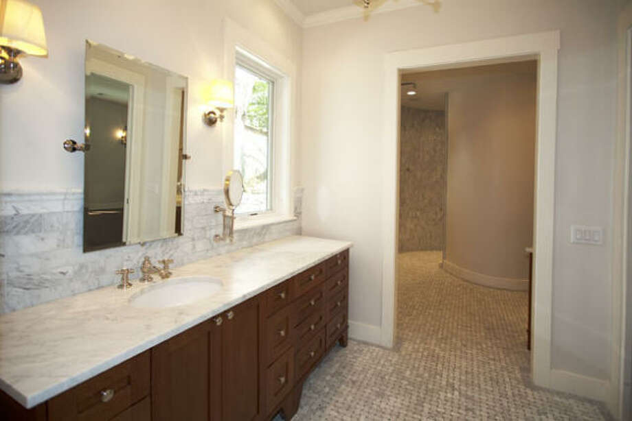 The master bath provides ample cabinetry, a separateshower and tub.