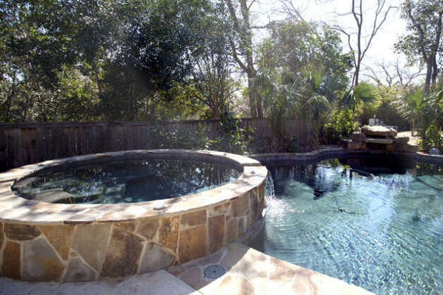 An outdoor area features a custom-sized Keith Zars pool with a spa.