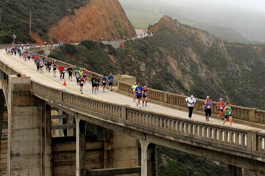Runners in the 2012 Big Sur marathon, from Big Sur to Carmel,  make their way across Bixy Bridge on Highway 1. Photo: Edie Ellis, Big Sur International Marathon