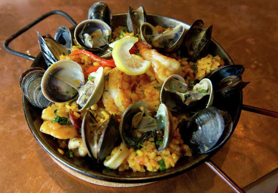 Seafood paella with mussels, scallops, claps, calamari, shrimp and rice at Picador restaurant in New Canaan on Thursday, March 7, 2013. Photo: Lindsay Perry / Stamford Advocate