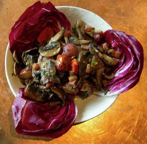 Tapas dish sautéed wild mushrooms with grapes, bacon, cherry tomato and aged sherry glaze at Picador restaurant in New Canaan on Thursday, March 7, 2013. Photo: Lindsay Perry / Stamford Advocate