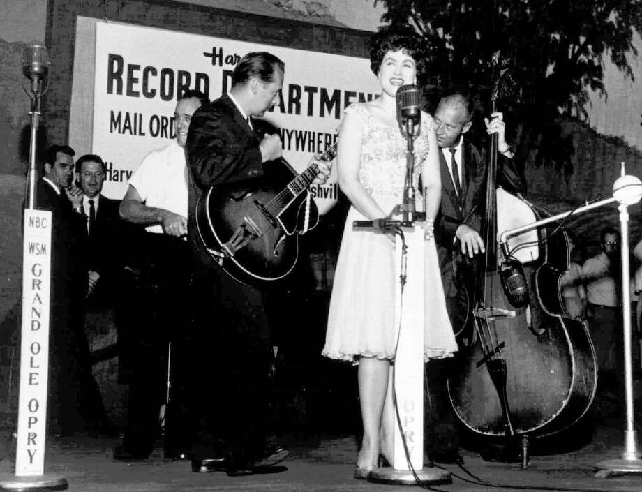 """Big voiced crossover country star scored her first hit with """"Walkin' After Midnight"""" in 1957 but Nelson wrote her most enduring hit. Cline's version of Nelson's """"Crazy"""" was released in late 1961 and reached past country listeners to hit No. 9 on the pop charts and resided in the Top 40 for two months. She died in a plane crash a little more than a year later at age 30. Photo: AP / TBS"""