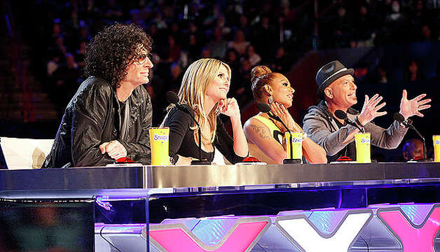 "This March 4, 2013 photo shows the judges for season eight of the talent competition series ""America's Got Talent,"" from left, Howard Stern, Heidi Klum, Mel B, and Howie Mandel during auditions in New Orleans. (AP Photo/NBC, Skip Bolen) Photo: Skip Bolen, Associated Press / NBC"