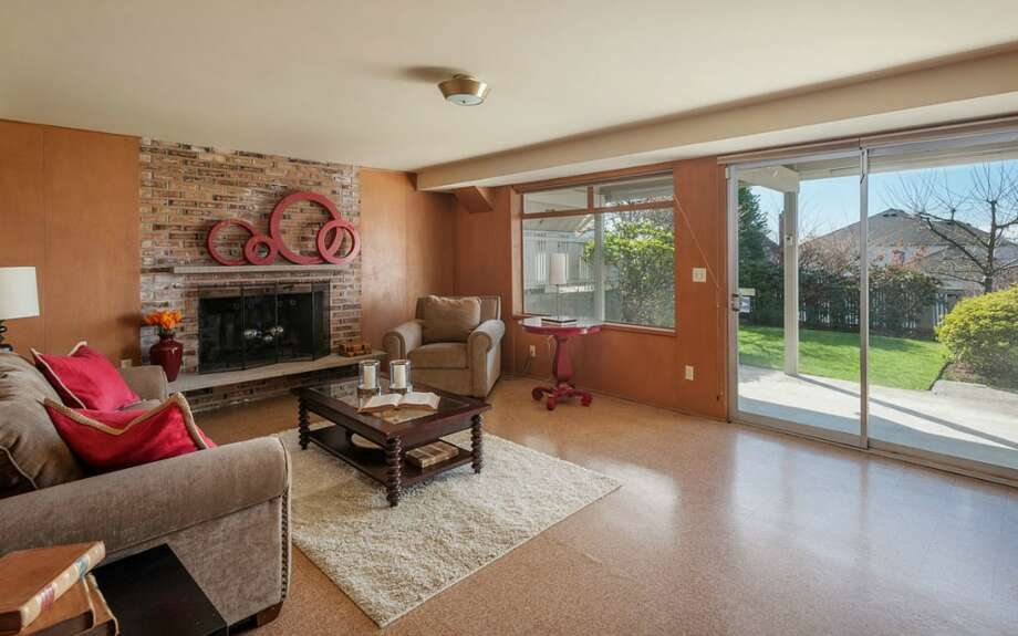 Rec room of 2335 Rosemont Place W. The 3,260-square-foot house, built in 1962, has four bedrooms, three bathrooms, a den, three fireplaces, a deck, a patio and views of Puget Sound and the Olympic Mountains on a 5,350-square-foot lot. It's listed for $759,000. Photo: Courtesy Virginia And Whitney Mason/Coldwell Banker Bain