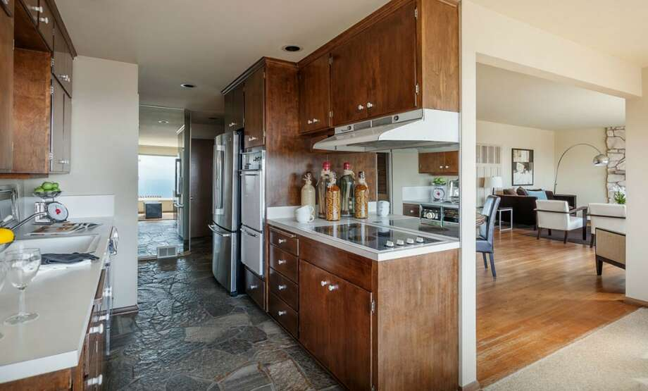 Kitchen of 2335 Rosemont Place W. The 3,260-square-foot house, built in 1962, has four bedrooms, three bathrooms, a den, a rec room, three fireplaces, a deck, a patio and views of Puget Sound and the Olympic Mountains on a 5,350-square-foot lot. It's listed for $759,000. Photo: Courtesy Virginia And Whitney Mason/Coldwell Banker Bain