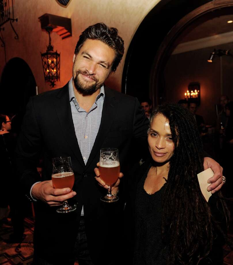 Actor Jason Momoa (L) and his wife actress Lisa Bonet pose at the after party for the premiere of HBO's Game Of Thrones at the Roosevelt Hotel on March 18, 2013 in Los Angeles, California. Photo: Kevin Winter, Getty Images / 2013 Getty Images