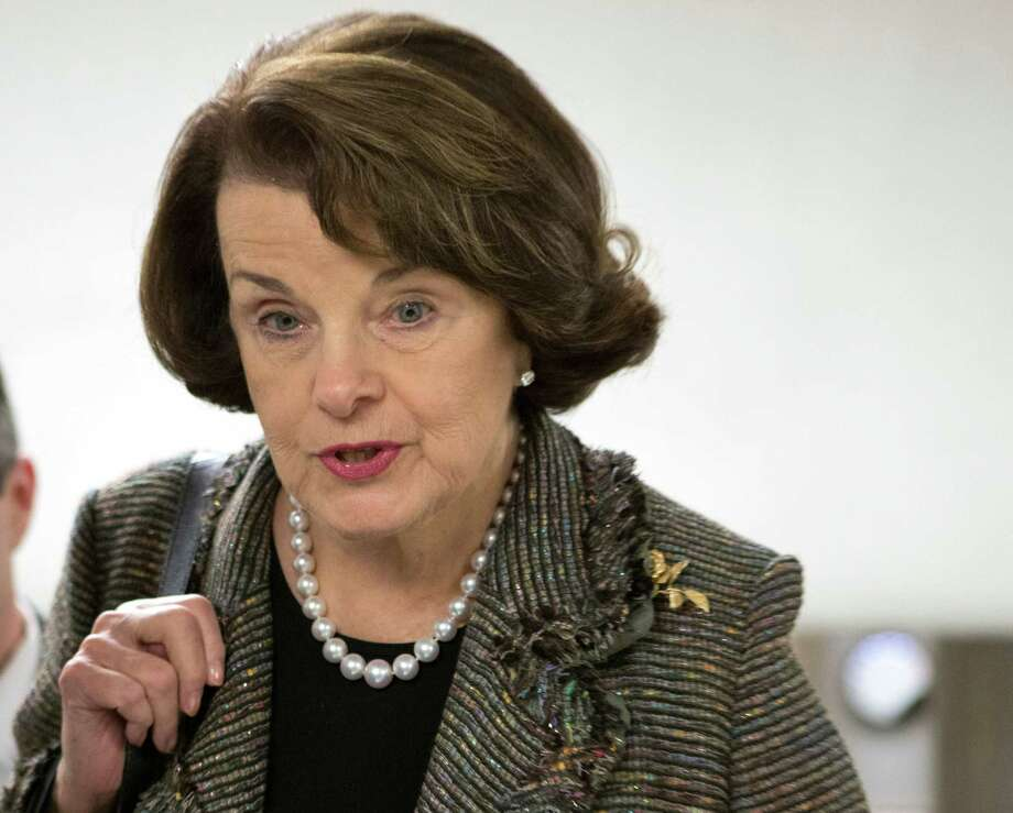 FILE - In this Feb. 25, 2013 file photo, Sen. Dianne Feinstein, D-Calif. speaks with reporters on Capitol Hill in Washington. Feinstein, the sponsor of a proposed assault weapons ban says Senate Majority Leader Harry Reid has told her that the ban will not be part of the initial gun control measure the Senate will debate next month. Photo: J. Scott Applewhite