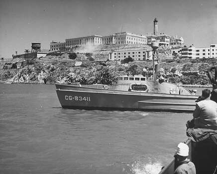 During the Battle of Alcatraz a flag flies at half mast during the prison riots. Photo: Charles E. Steinheimer., Time & Life Pictures/Getty Image