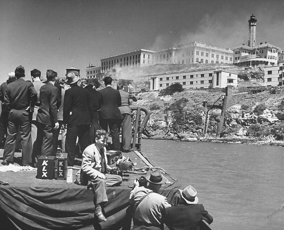 Exterior view of Alcatraz during the May 1946 prison riots, with press covering the riot just off shore. Photo: Charles E. Steinheimer, Time & Life Pictures/Getty Image