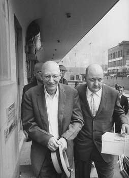 "Handcuffed convicted murderer Robert Stroud. along with an unidentified guard, leave a courthouse following an unsuccessful parole hearing in San Francisco in April 1962. While in various prisons, where he had been incarcerated since 1909, Stroud developed an interest in birds, writing several books on the subject and coming to be known, after his last prison transfer, as the ""Birdman of Alcatraz."" Photo: Art Shay, Time & Life Pictures/Getty Image"