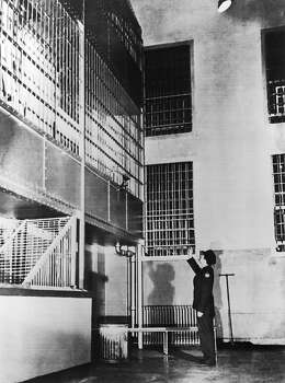 After retaking the cell house on May 5, 1946, a guard showed the spot from where prisoners Bernard Coy and his accomplices Marvin Hubbard, Miran Thompson, Sam Shockley and Clarence Cames tried to escape. During 44 hours of mutiny, The prisoners remained holed up in the main cell block. The authorities ended the battle with a combined assault of guards from other Federal prisons and military forces. Photo: Keystone-France, Gamma-Keystone Via Getty Images