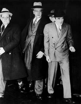 "Victor Lustig, right, on his way to Alcatraz prison in September 1935. He was an infamous con-artist who was best known as ""The man who sold the Eiffel Tower. Twice."" Photo: Keystone-France, Gamma-Keystone Via Getty Images"