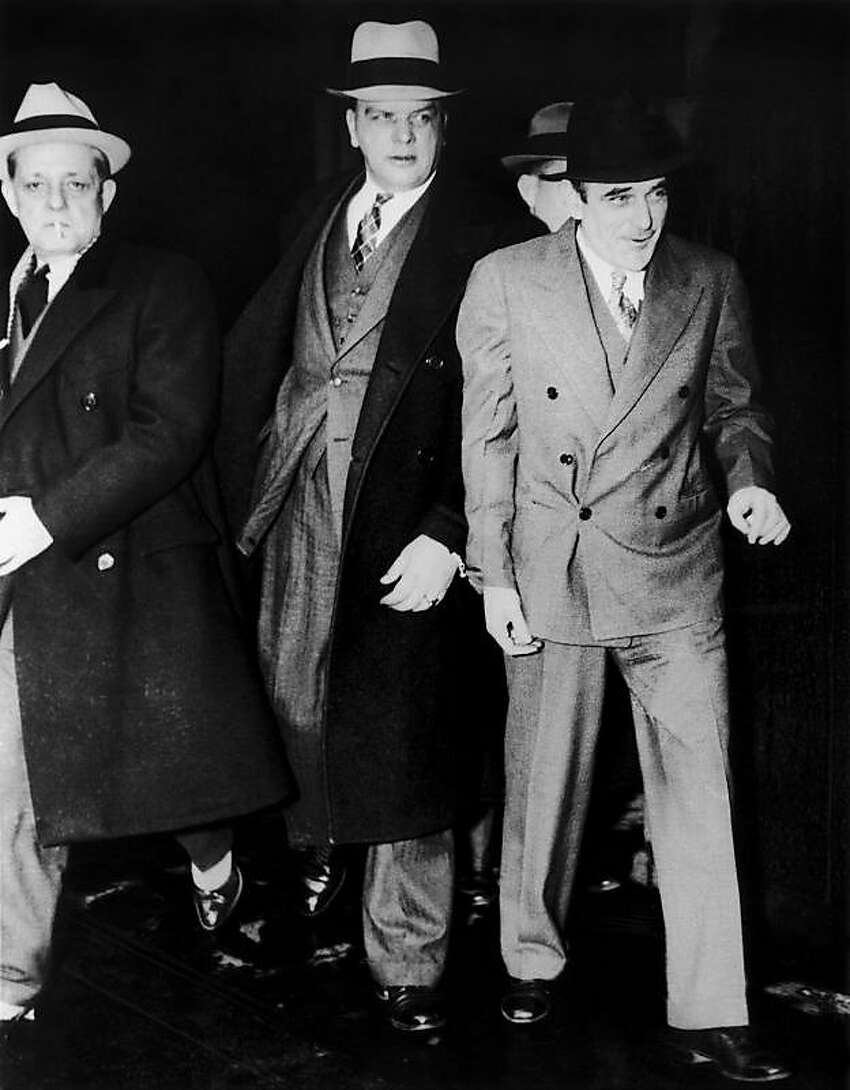 Victor Lustig, right, on his way to Alcatraz prison in September 1935. He was an infamous con-artist who was best known as