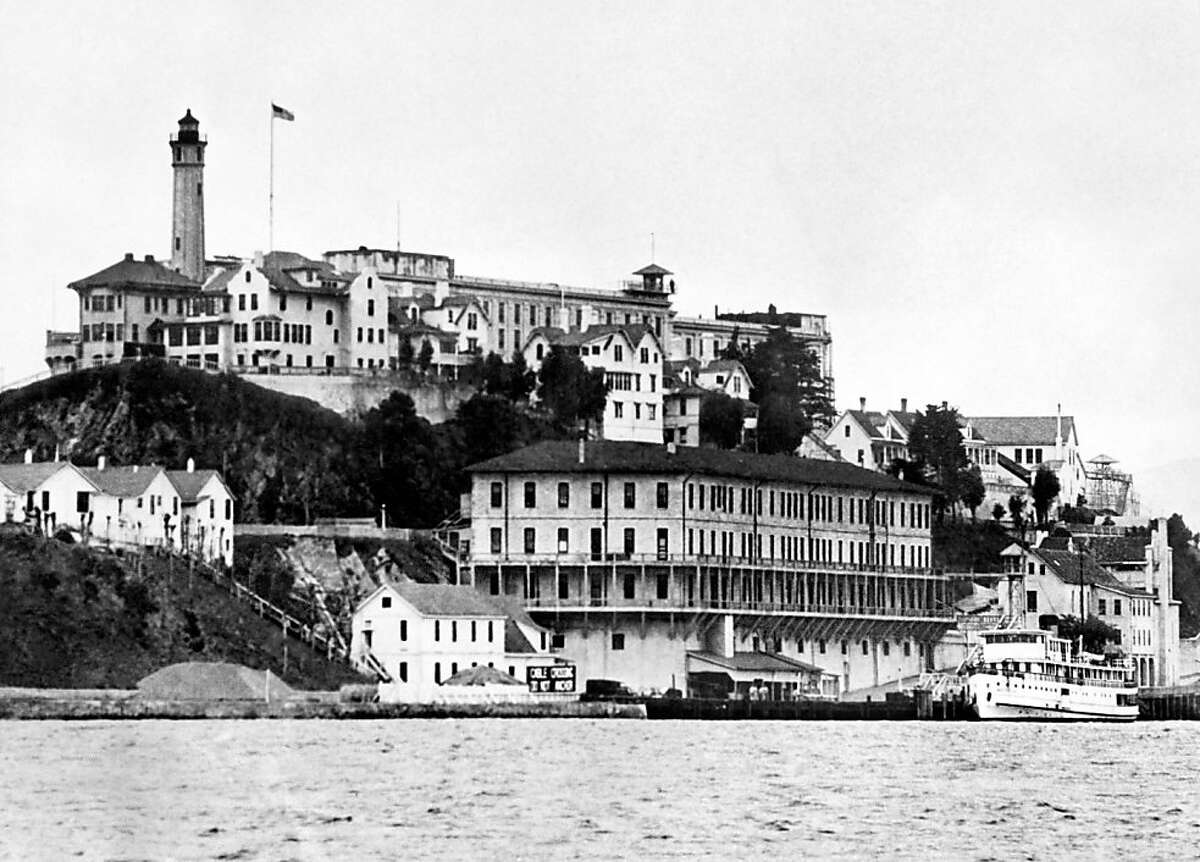 """A view from the 1930's of the Alcatraz island and penitentiary, in San Francisco Bay. Opened on August 11, 1934, Alcatraz (""""the Rock"""") was America's premier maximum-security prison, and for 29 years the final stop for the nation's most incorrigible inmates, including Al Capone. Alcatraz closed its doors 50 years ago, on March 21, 1963."""