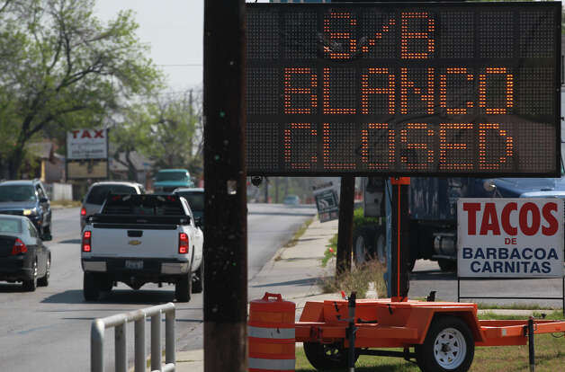 A sign on Fresno Drive warns motorists about a road closure on southbound Blanco Road that will take effect March 20, 2013. The southbound lane will be closed for six months between Fresno and San Francisco Street to reconstruct the roadway, curbs, driveways, sidewalks and intersecting streets as well as a drainage project. The northbound lane will remain open. Photo: JOHN DAVENPORT, SAN ANTONIO EXPRESS-NEWS / ©San Antonio Express-News/Photo may be sold to the public