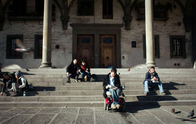 Reid Davenport sitting outside in Florence, Italy. Photo: Contributed Photo / The News-Times Contributed