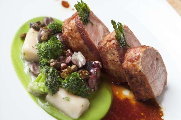 Bacon wrapped veal, potato gnocchi, broccoli cream, nicoise olives, octopus and bagna cauda at Auberge du Soleil.