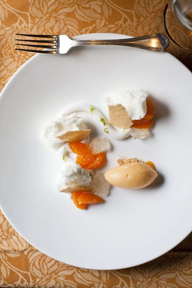 Coconut angel food cake, sweet coconut cream, mandarin sorbet, and lime at Auberge du Soleil.