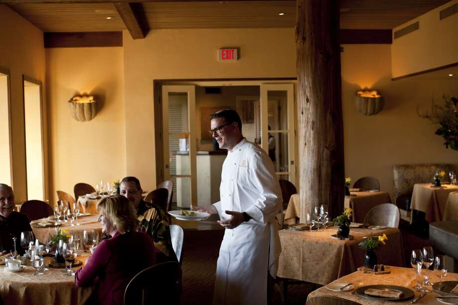 Executive chef Robert Curry of Auberge du Soleil chats with patrons in the dining room.