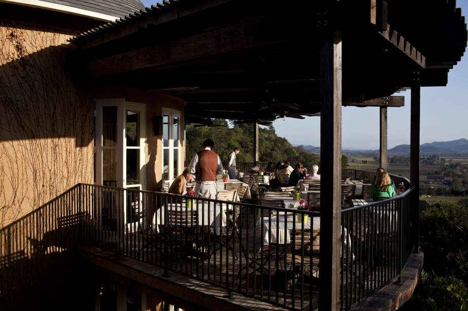 Guests dine on the outdoor patio overlooking the valley at Auberge du Soleil.