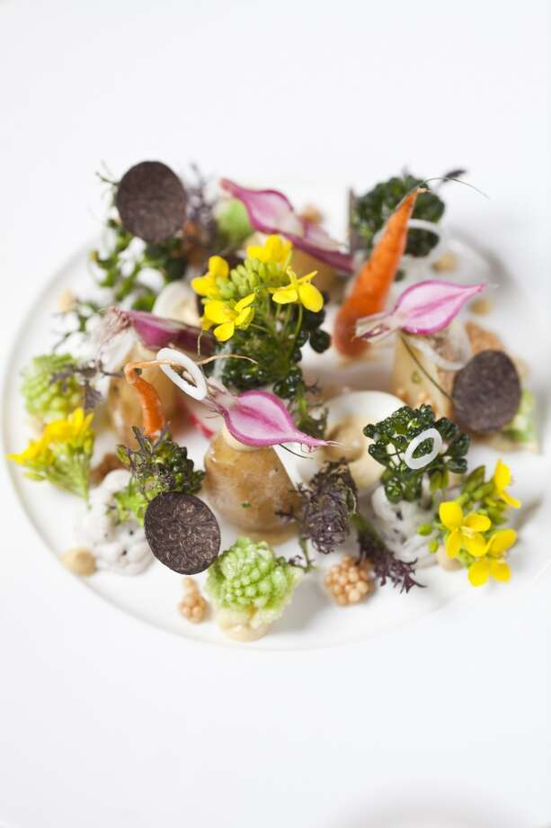 Sprouting garden vegetables, with crema di lardo, butterball potatoes, black truffle and smoked quail egg, mostly sourced from the grounds at restaurant Etoile at Domain Chandon.