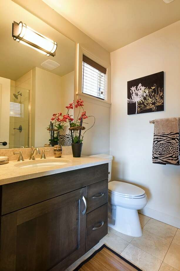 Bathroom of 3213 W. Lynn St. The 2,500-square-foot condominium townhouse, built in 2009, has three bedrooms, 2.75 bathrooms, a private elevator, a gated courtyard, travertine floors, two fireplaces and a storefront office. It's listed for $799,000. Photo: Courtesy Kathleen Madsen/Brazen Sothebys International Realty