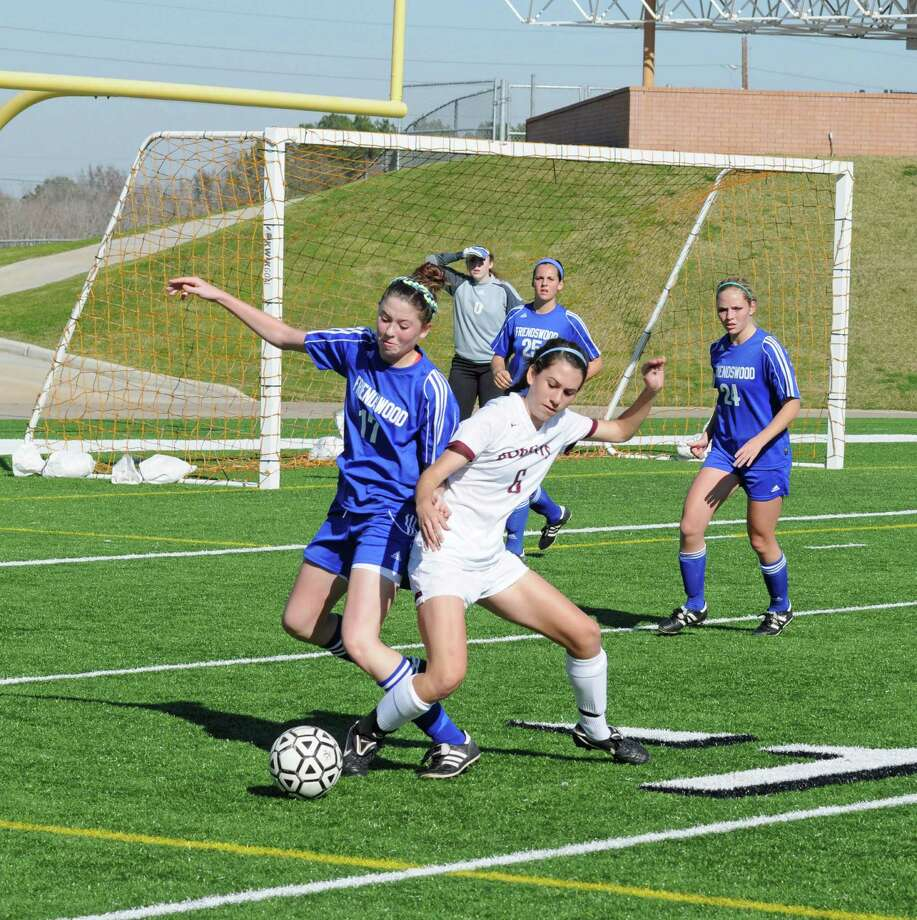 Cy-Fair junior Kortney DesCamp (6 at right) and the Lady Bobcats are in the 2013 soccer playoffs. The University Interscholastic League Class 5A soccer playoffs begin March 28-30. Photo: L. Scott Hainline / Freelance