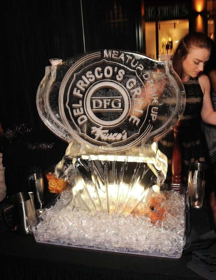 An ice sculpture at the grand opening party at Del Frisco's Grille at West Ave. Thursday March 14, 2013. Photo: Dave Rossman / © 2013 Dave Rossman