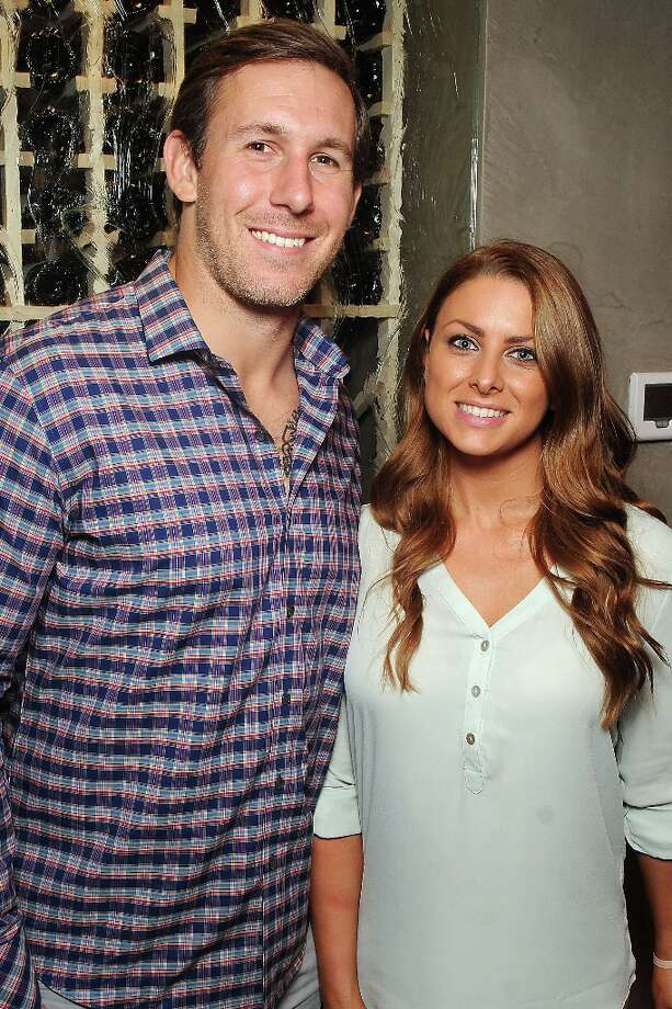 Houston Texan Owen Daniels and Angela Mecca at the grand opening party at Del Frisco's Grille at West Ave. Thursday March 14, 2013. Photo: Dave Rossman / © 2013 Dave Rossman