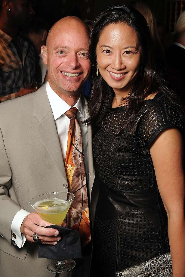 Mark Gianquitti and Melicia Tjoa at the grand opening party at Del Frisco's Grille at West Ave. Thursday March 14, 2013. Photo: Dave Rossman / © 2013 Dave Rossman