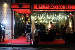 Guest are photographed entering the grand opening party at Del Frisco's Grille at West Ave. Thursday March 14, 2013.