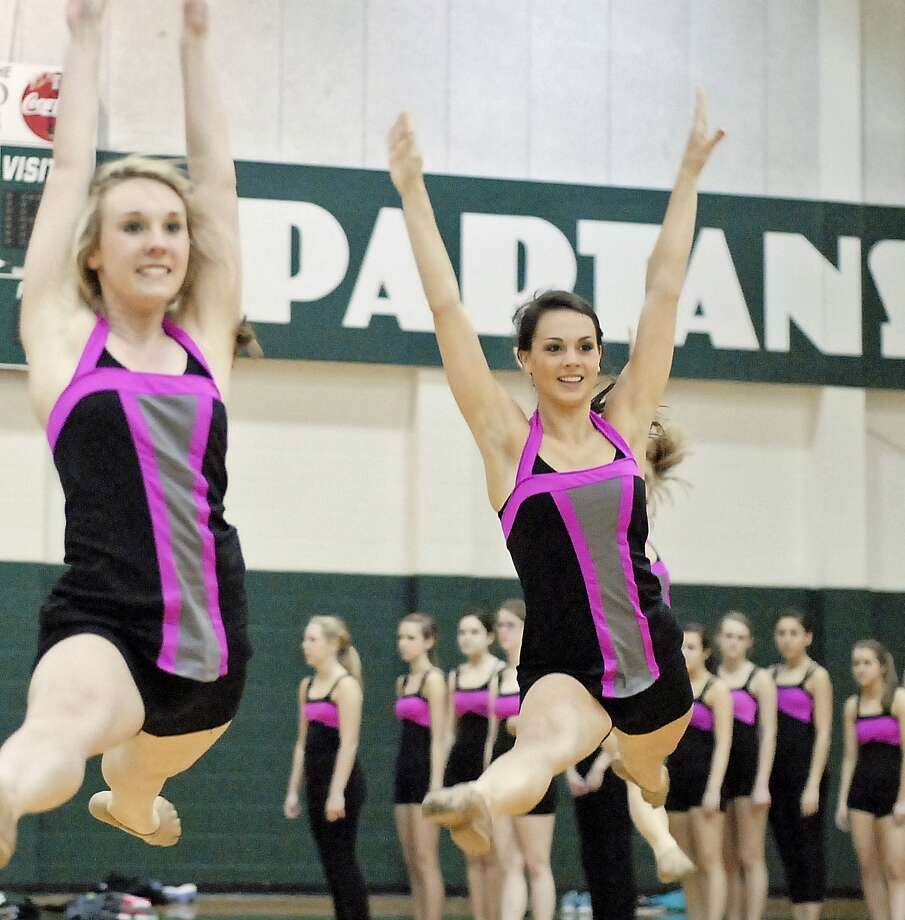 Stratford High School Spartanaires Hannah Vinyard, left, and Taylor Johnson practice in the school's gym. Photo:  Tony Bullard 2013, Freelance Photographer / © Tony Bullard & the Houston Chronicle